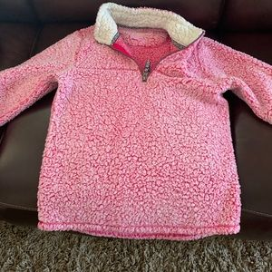 A soft pink fuzzy sweater. Wal-Mart brand